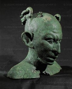 Vase in form of a male Syrian slave's bust. Bronze  Roman vase 1st-3rd CE  Louvre Museum