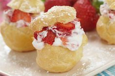 Cream Puffs Filled with Strawberry Cream- This delicious dessert is truly the cream of the crop! The light textured puffs are filled with fresh strawberries and mouth-watering whipping cream.