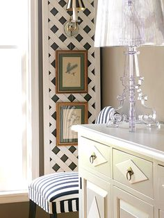 trellis on the wall with sconce (hides cord). hmmm....is there another way to hide the cords?