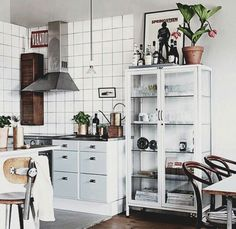Cute little white kitchen. Use art to style your tall cabinets. Are you looking for unique and beautiful art photo prints to decorate your interiors? Visit bx3foto.etsy.com