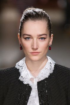 Tweak  the classic cat eye by opting for a more straight across swipe of black kohl like we saw at Oscar de la Renta. This is a more modern way to wear liner that elongates and lifts the eye and adds intrigue to the face.