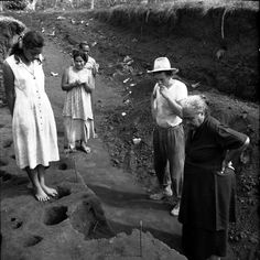 Vailele excavation 1957 Jack Golson and I'iga Pisa family visiting site. Photographer unknown