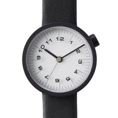 Draftsman 01-Scale 28mm (white/black) watch by nendo. Available at Dezeen Watch Store: www.dezeenwatchstore.com