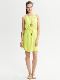 98.00 Banana Republic On seam pockets and a drawstring waist add functionality to this lovely frock. Halter neck. Sleeveless. Shirring at neck. Drawstring waist. On seam pockets. Shirttail hem.