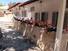 Luxurious minimalist, White Suites Resort in Afitos Halkidiki breathes purity and sophistication. Sidewalk, Minimalist, Luxury, Walkways, Pavement, Curb Appeal