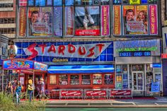 Eat at Ellen's Stardust diner - a 50's themed restaurant in times square.