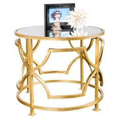 """Artfully handcrafted, this glamorous side table showcases a mirrored top and openwork iron base. Use it to display a chic lamp in your master suite or stack fashion magazines in the living room.   Product: Side tableConstruction Material: Iron and mirrored glassColor: GoldFeatures: HandcraftedDimensions: 18.5"""" H x 22"""" Diameter"""