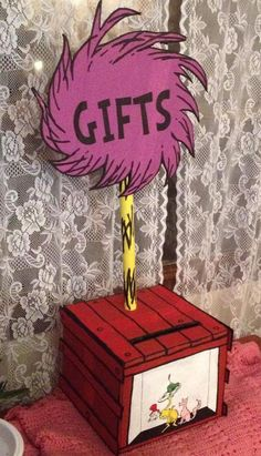 This Dr. Seuss GIFTS table centerpiece was made from two cardboard boxes and a w… This Dr. Seuss GIFTS table centerpiece was made from two cardboard boxes and a wrapping paper tube. I taped. 2nd Baby Showers, Baby Shower Themes, Baby Boy Shower, Dr Seuss Baby Shower Ideas, Twin First Birthday, Baby Birthday, First Birthday Parties, Birthday Ideas, Dr Seuss Party Ideas