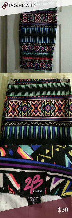 NWOT Bebe Pencil Skirt Multicolored print, elastic waist, polyester, spandex blend, makes this skirt a true fit. This can be worn with any color top. Dress it up, dress it down.  Work, office, casual, this is a must have. I was attracted to the color, I didnt pay attention to the size, never worn. Offers welcome. bebe Skirts Pencil