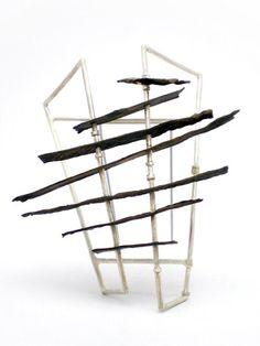 Panel Brooch (2011) White metal, brass, steel. 72x66x30mm