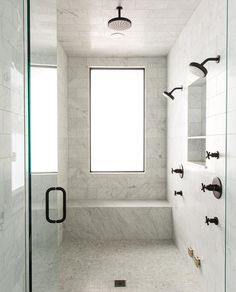 White Marble Shower With Matte Black Plumbing Fixtures