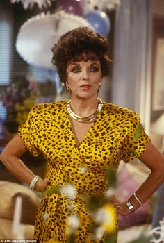 Acting icon: Joan also starred as Alexis Carrington Colby on the American TV series Dynasty Alexis Carrington, Dynasty Tv Show, Der Denver Clan, Dame Joan Collins, Hollywood Costume, Blouse And Skirt, Wrap Blouse, Anna Nicole Smith, Nostalgia