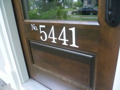 Vinyl house numbers. Vinyl is NOT expensive to get custom-cut from a sign shop.
