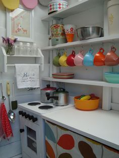 I like these cup hooks - cute way to display mugs and take advantage of the unused space while opening more space in the cabinets