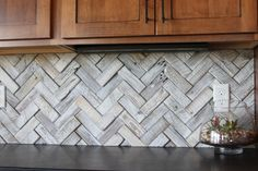 Herringbone backsplash Handmade tiles can be colour coordinated and customized re. shape, texture, pattern, etc. by ceramic design studios