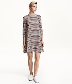 Short, flared dress in woven fabric with 3/4-length sleeves, decorative gathers at the back and an opening with a button at the back of the neck. Unlined.