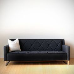 Gus Modern Thatcher Sofa - I like the diamond design on the back and seat. Doesn't look like it would be too heavy for our space either