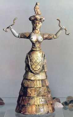minoan Snake Goddess wearing bodice w/exposed breasts and apron skirt, (2900-1150 B.C.)