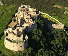 Helfstyn Castle, Lipník nad Becvou, Prerov, Olomouc, Czech Republic  http://www.castlesandmanorhouses.com/photos.htm  The ruins of the castle are perched on a knoll above the narrowest part of the Moravian Gate and above the left bank of the river Becva.  The complex is 187 meters long and up to 152 meters wide. It is one of the largest castles in terms of area in the Czech Republic.