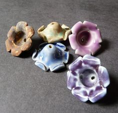 Porcelain blossom bead caps by RoundRabbit, via Flickr...her stuff is so gorgeous, soon to open (??) on Etsy