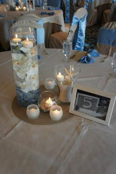non floral centerpiece @ beach themed wedding Simply Events LLC www.simplyeventsllc.com