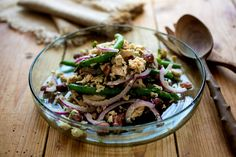 This is the most amazing version of tuna and bean salad I've ever tasted It incorporates crunchy green beans, a red onion made a little milder by soaking in water, tuna and a bean of your choice I've used a lush bean called Good Mother Stallard, which really makes this salad stand out