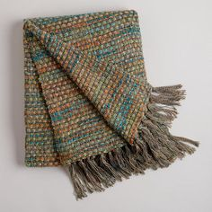 One of my favorite discoveries at WorldMarket.com: Green Dots Woven Throw.  I just love the colors in this cozy throw.