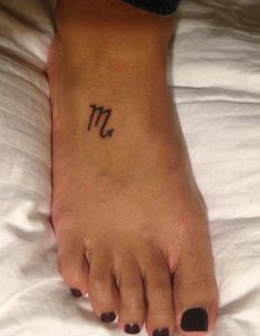 Sign of the Scorpio tattoo on my foot. To signify that every decision I make, every step I take, has a reward/consequence, and that I need to be true to myself.