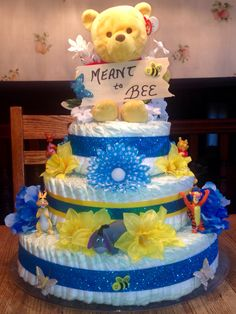 Winnie the Pooh diaper cake #glitter #flowers #winniethepooh #diapercake