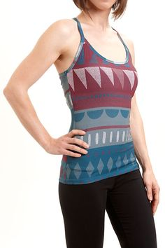 The print on the Mural tank top was inspired by a wall painting created by the children at Milagro school, making it a very special piece. This top has an integrated bra and removable foam cups for extra support. The recycled polyester fabric is quick drying and ideal for all active training. It is a perfect yoga and dance wear. A percentage of the sale of this garment is used to build classrooms and pay for the school fees of the underprivileged children in Peru who inspired the collection.