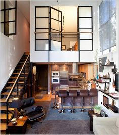 both of the bedrooms in this 1.1 million dollar san francisco condo are on the second level, partly enclosed with retractable steel-frame windows.