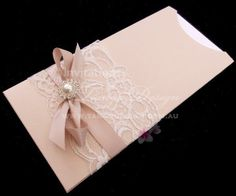Lace wedding invitations, sleeve style with pearls, lace and ribbon. Nude rose or quartz pink with ivory cards by http://www.tangodesign.com.au #lacepearlsinvite #vintagelaceinvitations #laceinvitations