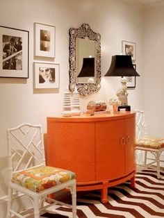 lacquer cabinet with two side chairs in kitchen for serving space and additional seating.