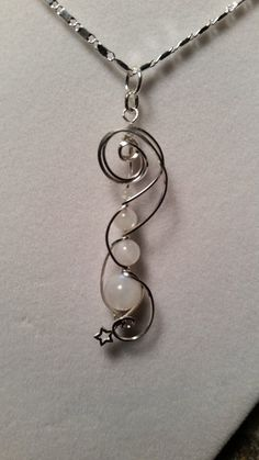"Handmade , hand-wrought Sterling silver wire wrapped pendant, with Moonstone round gemstone beads and a tiny little star. on 925 20"" chain."