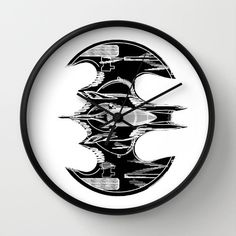 "Clock, Clock batwing, batwing Patent Clock, Modern Clock, The batman Clock, batman batwing clock, Batman clock by STANLEYprintHOUSE  47.00 USD  Available in natural wood, black or white frames, our 10"" diameter unique Wall Clocks feature a high-impact plexiglass crystal face and a backside hook for easy hanging. Choose black or white hands to match your wall clock frame and art design choice. Clock sits 1.75"" deep and requi ..  https://www.etsy.com/ca/listing/242951257/clock-clock-.."
