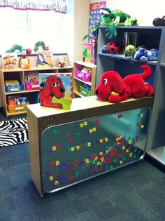 Attach a large metal drip pan to the back of a bookshelf to make a word-work center. Attach a large metal drip pan to the back of a bookshelf to make a word-work center. New Classroom, Classroom Setting, Classroom Design, Classroom Ideas, Preschool Classroom Layout, Preschool Library Center, Classroom Libraries, Toddler Classroom Decorations, Daycare Decorations