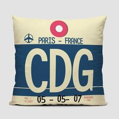 Throw pillow inspired on vintage travel luggage tags from Paris Roissy Charles de Gaulle Airport. IATA code CDG.