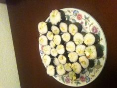 Homemade sushi rolls..steamed rice, rice vinegar, avocado, egg, and cucumber. My daughter loves!