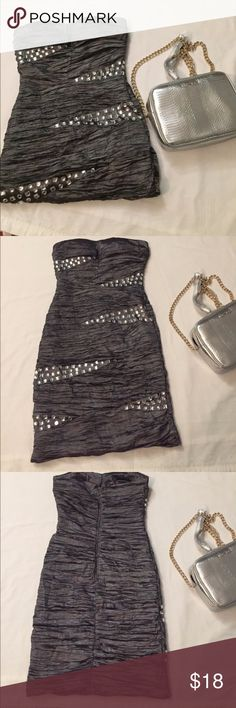 Bodycon Dress Effortlessly slay in this gem! It's strapless, studded, silver and sexy! Made of polyester (39%), cotton, polyamide (27%) and spandex (3%). The lining is 100% polyester. No flaws! Only worn once for a fashion show. Arden B Dresses Strapless