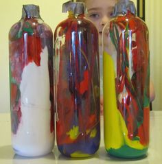 Irresistible Ideas for play based learning » Blog Archive » painting inside the bottles