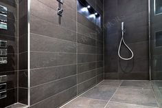 Attention to every detail - V&B tiles are perfectly lines up in this wetroom design