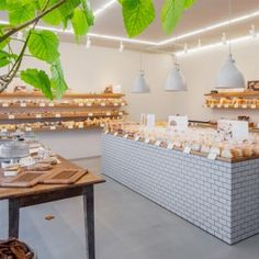 Style Bakery by SNARK features  tiled walls and oak shelving