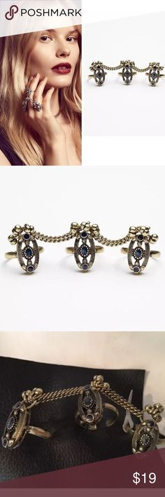 FREE PEOPLE TRIPLE BELLS RING SET BOHO NAVY FREE PEOPLE TRIPLE BELLS RING SET Set of triplet malleable (adjustable to fit any finger) rings connected by a chain. Bell charm accents.   This listing is for the rings with the navy stone same style as shown on model but not the white stone  *By Free People   *Metal  *Import Free People Jewelry Rings