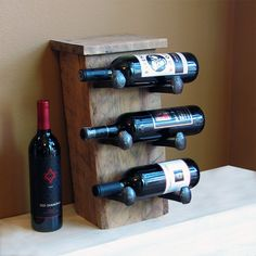 Rustic wine rack, counter wine bottle holder with railroad spike hooks. $75.00, via Etsy.