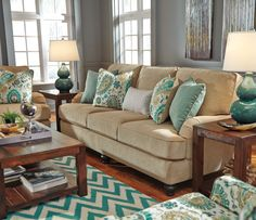 Look at this beautiful living room collection. The color on these accent pillows are amazing!