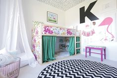Pink, black and white set the stage for this adorable girl's room. Stephanie of The Divine Living Space added custom touches throughout the space. (Notice the fun Dalmatian-spotted ceiling!) The IKEA bed complete with a reading nook below and loft bed above is brilliant. See more at The Divine Living Space