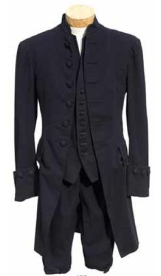 A Henry Fonda suit from Drums Along the Mohawk 20th Century Fox, 1939. Comprising a navy blue wool collarless overcoat with self-covered buttons, a navy blue wool vest with a green-lettered