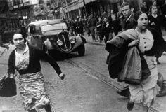 Spain. Bilbao. Running for shelter during the air raids, Spanish Civil War, May 1937 // By Robert Capa