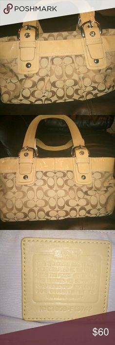 """*Labor Day Sale *Authentic Coach monogrammed purse Great condition! It's a creamed color with brown lettering. Very beautiful leather straps. Zippers work and there is one inside zip compartment and a phone holder and another drop pocket. The measurements are 9""""h by 14"""" w not including the straps. This is a beautiful purse and way worth the money!! Coach Bags Shoulder Bags"""