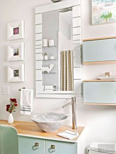 Perk up a clearance-find mirror with just a few strips of tape and your favorite color of spray paint. Mask off stripes on the mirror using thin artist's tape and parchment paper before spray-painting white. Remove the tape before the paint is completely dry to avoid peeling./